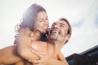 Close-up of man giving piggy back to woman