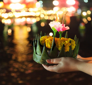 Woman holding kratong in her hands
