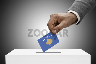 Black male holding flag. Voting concept - Kosovo