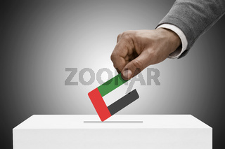 Black male holding flag. Voting concept - United Arab Emirates
