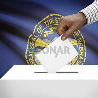 Voting concept - Ballot box with US state flag on background - Nebraska