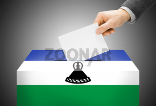 Voting concept - Ballot box painted into national flag colors - Lesotho