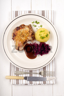 pork chop with red cabbage, gravy and potato dumpling