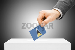 Voting concept - Male inserting flag into ballot box - Saint Lucia