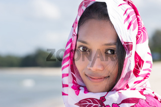 Portrait of a woman shrouded in a scarf