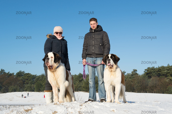 Owners with rescue dog in snow