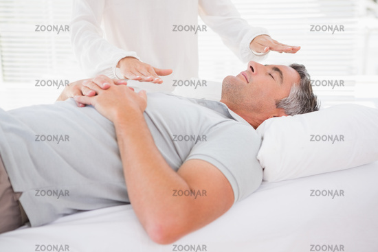 Therapist working with man