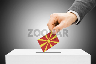 Voting concept - Male inserting flag into ballot box - Republic of Macedonia