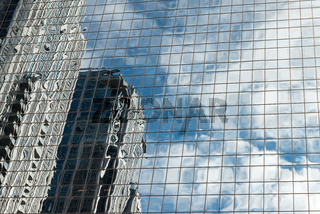 Futuristic view of glassy skyscraper walls reflected in each other