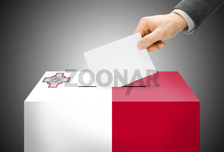 Voting concept - Ballot box painted into national flag colors - Malta