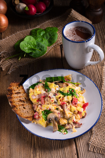 Scrambled eggs with tomatoes and spinach