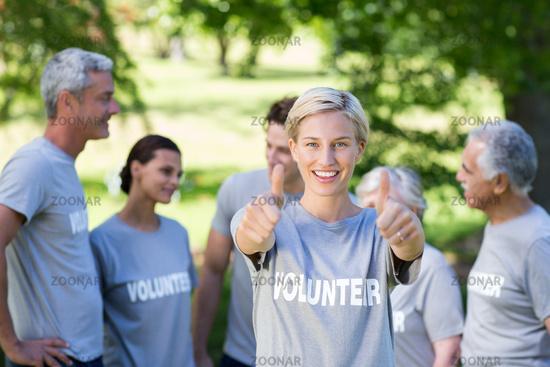 Happy volunteer blonde with thumbs up