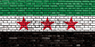 flag of Syrian Republic painted on brick wall