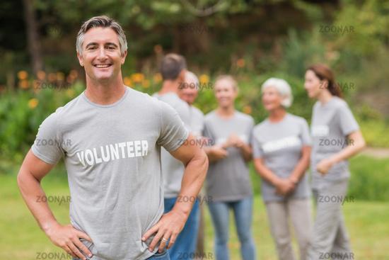 Smiling volunteer looking at camera