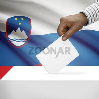 Ballot box with national flag on background - Slovenia