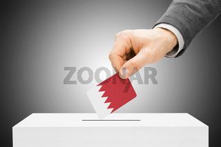 Voting concept - Male inserting flag into ballot box - Bahrain