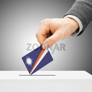 Voting concept - Male inserting flag into ballot box - Marshall Islands