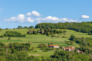 Rural houses on green pasture in Piedmont, Italy.