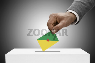 Black male holding flag. Voting concept - French Guiana