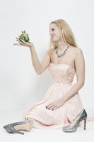 Young woman holding Frog King