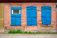Old wooden blue window of slum house in Astrakhan, Russia