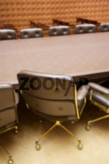 Background blur of stylish empty conference room ready for a meeting.