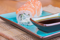 California maki sushi with fish and soy sauce