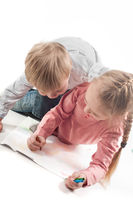 Little girl and boy painting