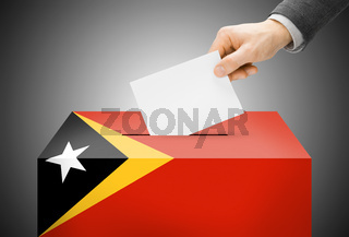 Voting concept - Ballot box painted into national flag colors - East Timor