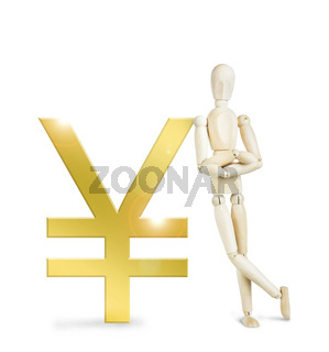 Man leaned against a huge golden Yen sign. Abstract image with a wooden puppet