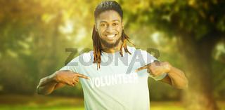 Composite image of happy volunteer in the park