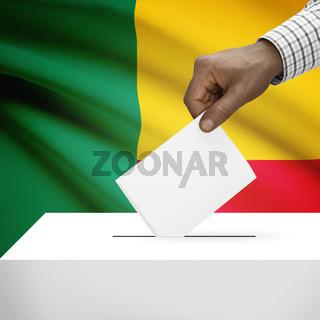 Ballot box with national flag on background - Benin