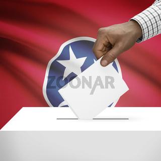Voting concept - Ballot box with US state flag on background - Tennessee