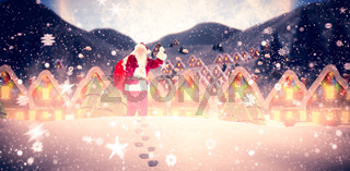 Composite image of santa ringing his bell