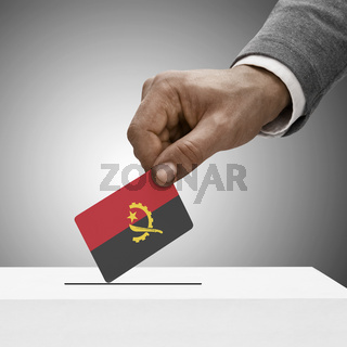 Black male holding flag. Voting concept - Angola