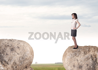 Businesswoman on rock mountain