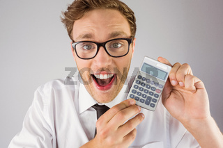 Geeky businessman showing a calculator
