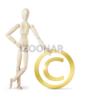 Man leaned against a large golden Copyright sign. Abstract image with a wooden puppet