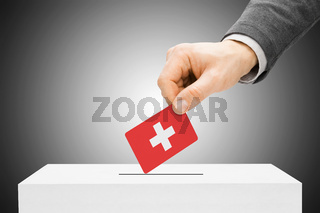 Voting concept - Male inserting flag into ballot box - Switzerland