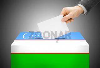 Voting concept - Ballot box painted into national flag colors - Uzbekistan