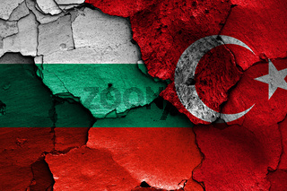 flags of Bulgaria and Turkey painted on cracked wall