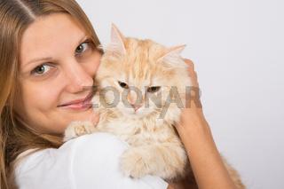 Girl hugging a disgruntled cat