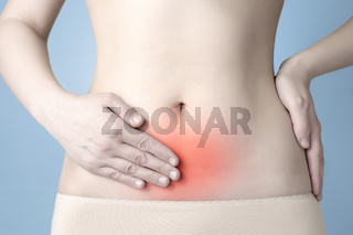 Young woman having stomach ache