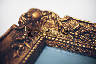Detail of an antik gold picture frame