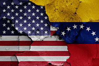 flags of USA and Venezuela painted on cracked wall