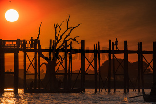 Silhouettes at U Bein teak bridge. Myanmar