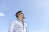bearded man blue sky