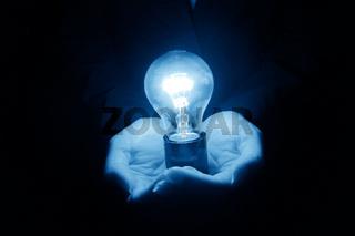 lamp in hand idea concept