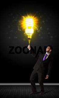 Businessman with an eco-friendly bulb