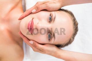 pretty blonde receiving head massage
